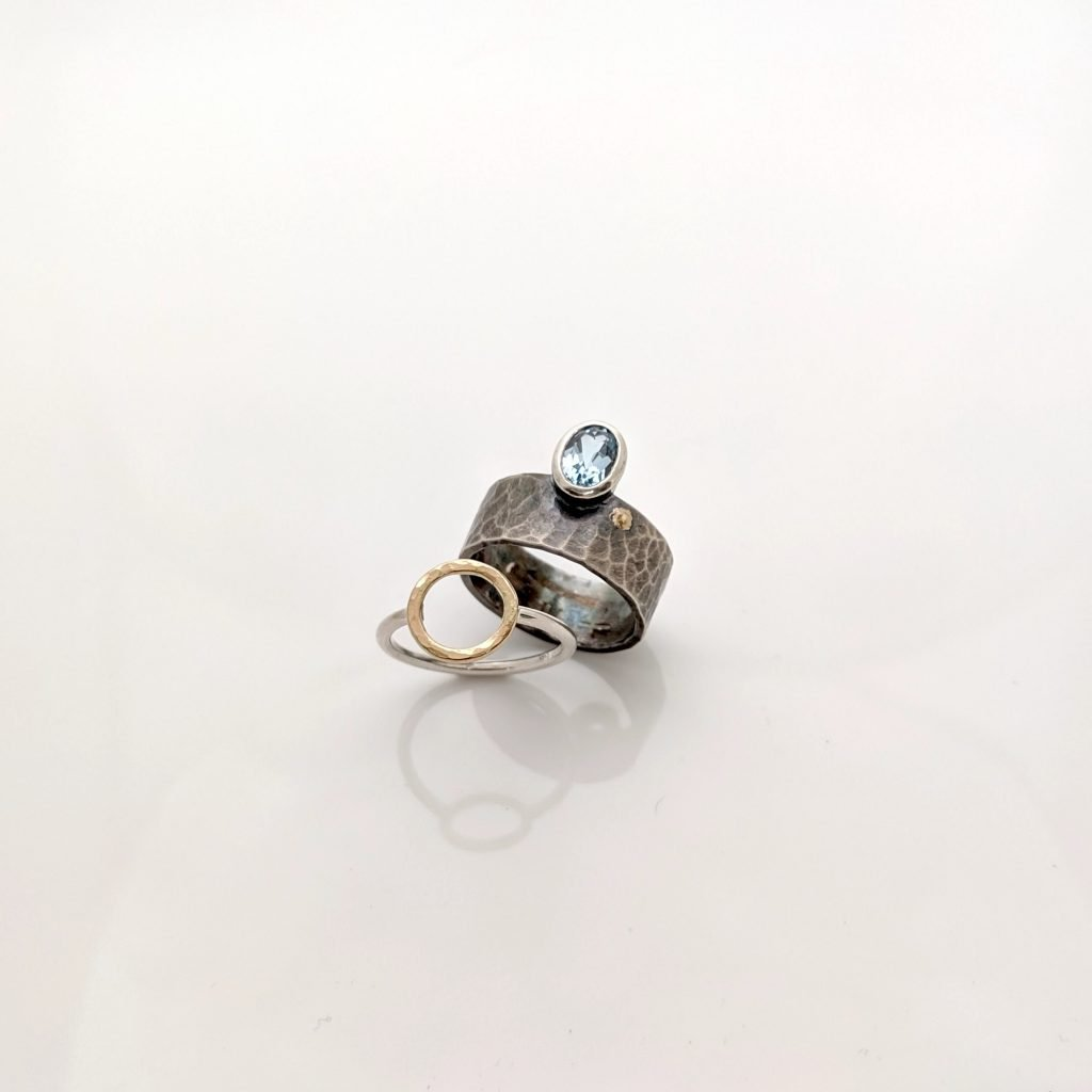 Offset Topaz Ring, and Minimal Aro Ring by Rocky Pardo